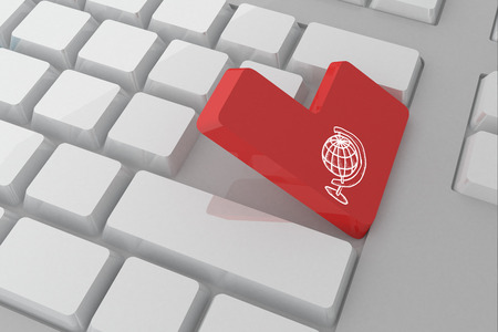 Globe against white keyboard with red key photo