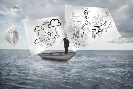 Composite image of happy businessman looking away in a sailboat in ocean photo