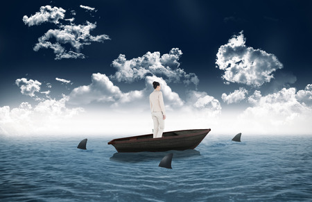 circling: Composite image of asian businesswoman against sharks circling small boat in the sea Stock Photo