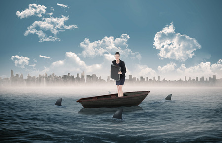 circling: Elegant businesswoman in suit carrying briefcase against sharks circling a small boat in the sea Stock Photo