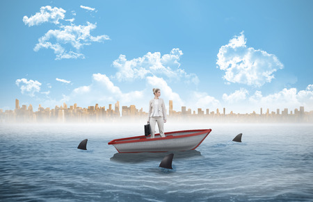 circling: Serious classy businesswoman holding briefcase posing against sharks circling a small boat in the sea