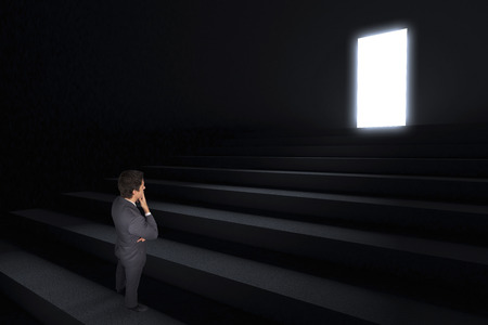 leading light: Thinking businessman touching his chin against steps leading to light in the darkness
