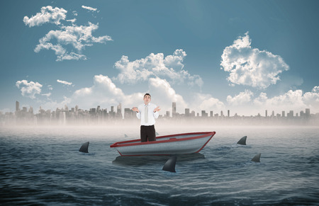 circling: Portrait of a clueless businessman posing against sharks circling a small boat in the sea