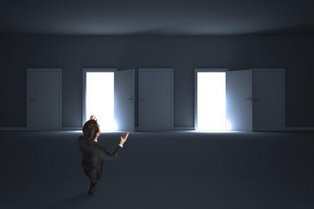 Stressed businessman gesturing against doors opening revealing light photo