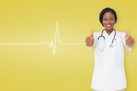 Young nurse giving thumbs up against medical background with ecg line in yellow photo