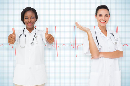 Composite image of medical team against ecg line on white background with grid photo