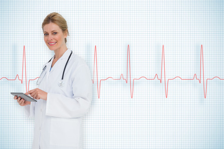 Blonde doctor using tablet pc against ecg line on white background with grid photo