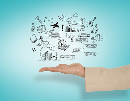 Female hand presenting computing icons against blue vignette photo