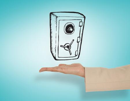 Female hand presenting locked safe against blue vignette Stock Photo - 29005043