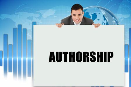 authorship: Businessman showing card saying authorship against digital background