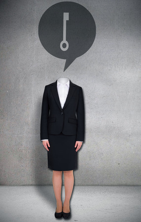 Composite image of headless businesswoman with key in speech bubble in grey room photo