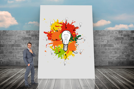 composite image: Composite image of thinking businessman against white card Stock Photo