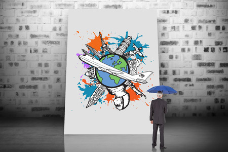 Composite image of businessman holding umbrella against white card photo