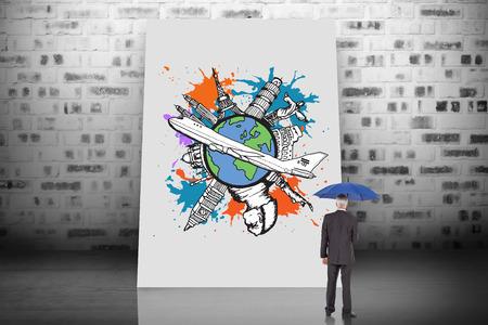 Composite image of businessman holding umbrella against white card photo