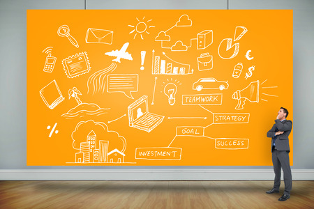 Composite image of thinking businessman against orange card photo