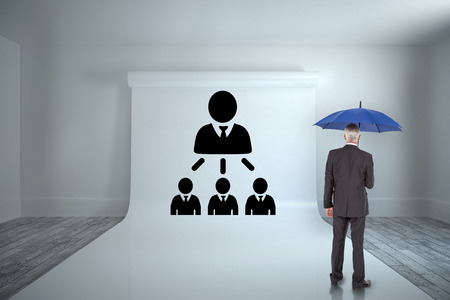 organisational: Businessman holding umbrella against large white screen showing graphic Stock Photo