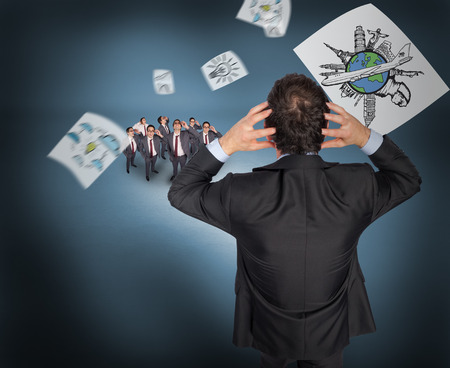 taken: Stressed businessman with hands on head with tiny businessmen against purple vignette Stock Photo
