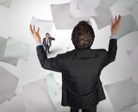 Gesturing businessman with tiny businessman against grey vignette photo
