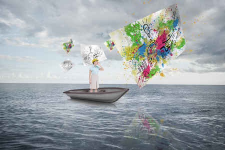 Composite image of attractive architect yelling in a sailboat against cloudy sky and ocean photo