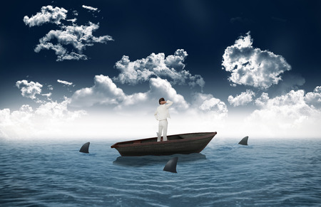 circling: Thinking businesswoman against sharks circling small boat in the sea Stock Photo