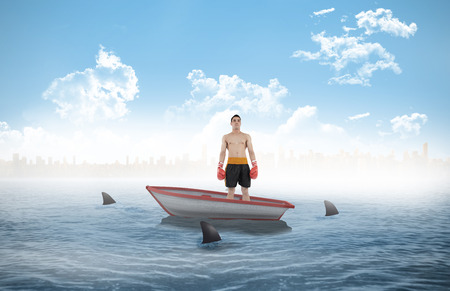 circling: Boxer standing against sharks circling a small boat in the sea
