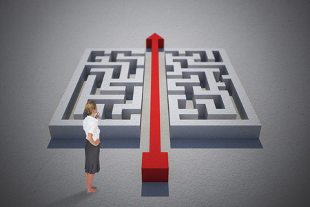 cutting through: Thinking businesswoman against red arrow cutting through puzzle