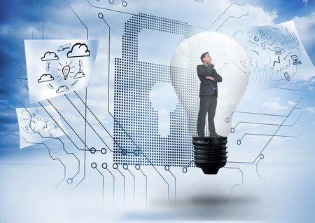 Thinking businessman in light bulb against giant padlock with circuit board and drawings floating around photo