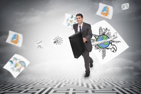Smiling businessman in a hurry against maze ending in cloudy sky photo