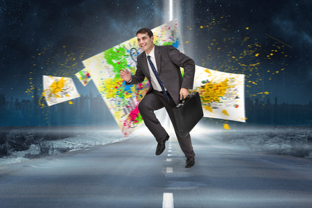 Cheerful businessman in a hurry against road leading out to the horizon with light beam photo