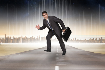 Cheerful businessman in a hurry against cityscape on the horizon photo