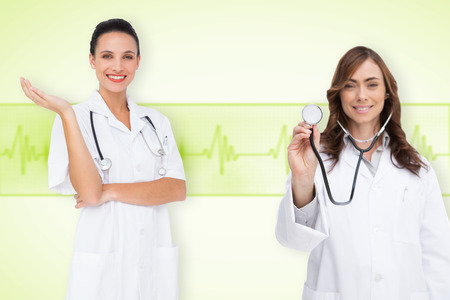 Composite image of medical team against medical background with green ecg line photo