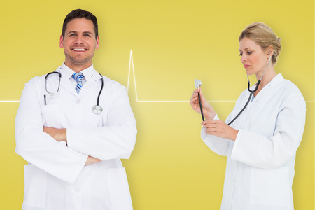Composite image of medical team against medical background with ecg line in yellow photo