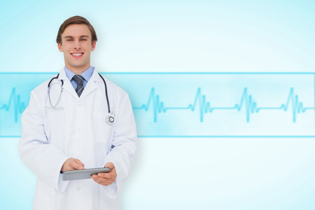 Young doctor using tablet pc against medical background with blue ecg line