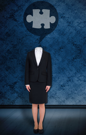 Composite image of headless businesswoman with jigsaw in speech bubble against dark grimy room photo