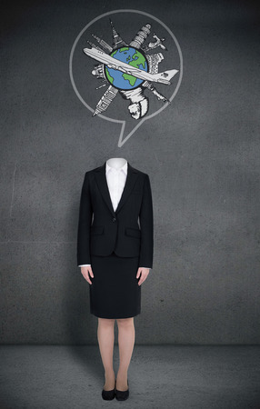 Composite image of headless businesswoman with globe in speech bubble in grey room photo