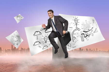 Cheerful businessman in a hurry against road turning into arrow photo