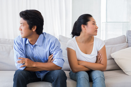 not talking: Couple not talking after a dispute on the sofa at home in the living room
