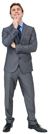 Thinking young businessman in grey suit on white background