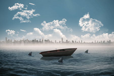 circling: Digitally generated sharks circling a small boat in the sea