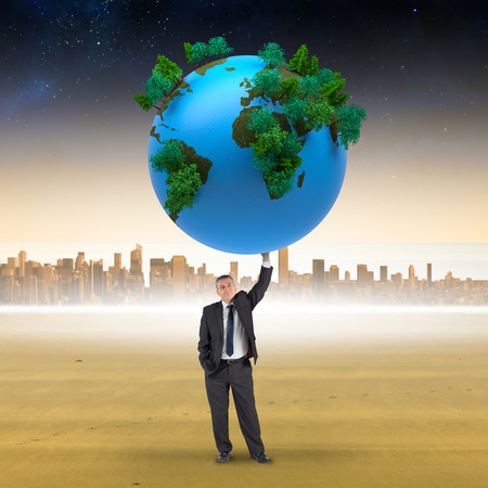 businessman carrying a globe: Composite image of businessman holding earth against cityscape on the horizon