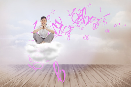 Businesswoman sitting cross legged with hands together against clouds in a room photo
