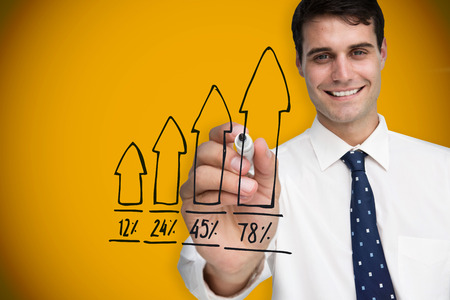 Composite image of businessman drawing graph against yellow background with vignette photo
