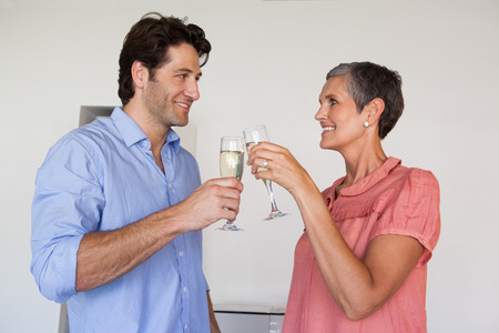 Casual successful business team toasting with champagne in the office photo