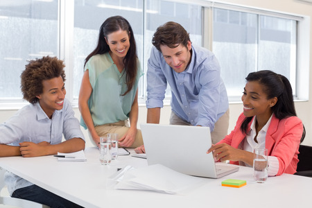 Team of architects going over blueprints in the office photo