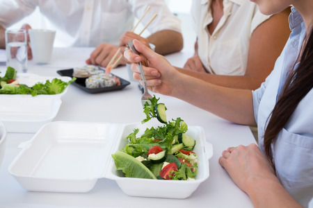 Business people enjoying salad and salad for lunch in the office photo