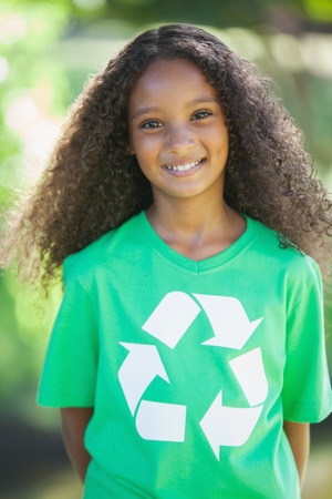 activist: Young environmental activist smiling at the camera on a sunny day