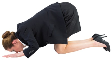 bending down: Businesswoman on all fours on white background