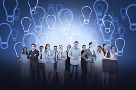 Digital composite of business team against light bulb background photo