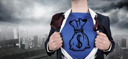 Businessman opening his shirt superhero style against balcony overlooking city photo
