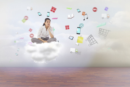 slumped: Businesswoman sitting cross legged thinking against clouds in a room Stock Photo